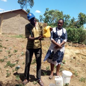 The Water Project:  Training On How To Make A Handwashing Station
