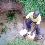The Water Project: Shikangania Community, Abungana Spring -  Fetching Water