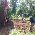 The Water Project: Lusiola Community, Ifetha Spring -  Working On A Mud Home