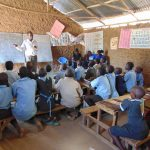 The Water Project: Namakoye Primary School -  Sanitation Teacher Talking To The Ctc Club
