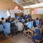 The Water Project: Namakoye Primary School -  Sanitation Teacher Talking To The Ctc Club