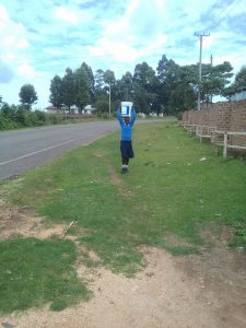 The Water Project:  A Girl Returning From Fetching Extra Water From Home