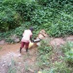 The Water Project: Kisasi Community, Edward Sabwa Spring -  Fetching Water