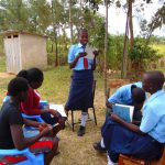 The Water Project: Musango Mixed Secondary School -  A Participant Reads Her Answers Out Loud