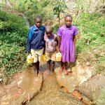 The Water Project: Chiliva Primary School -  Students At The Spring