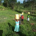 The Water Project: Sasala Community, Kasit Spring -  Carrying Water Home