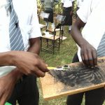The Water Project: Ebubere Mixed Secondary School -  Crushing Charcoal For Toothpaste Substitute