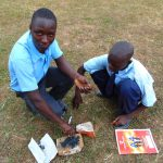 The Water Project: Musango Mixed Secondary School -  Crushing Charcoal For Brushing