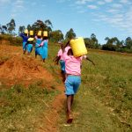 The Water Project: Irovo Orphanage Academy -  Carrying Water Back To School