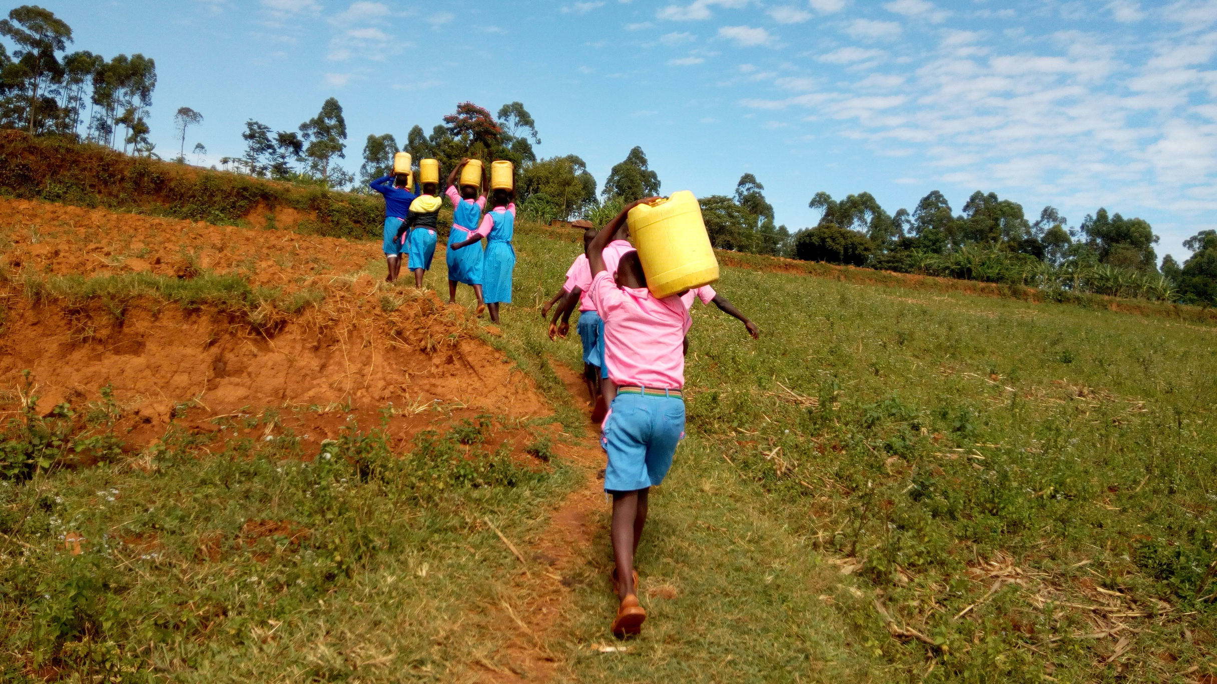 The Water Project : 8-kenya19046-carrying-water-back-to-school