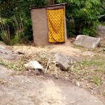 The Water Project: Bumira Community, Imbwaga Spring -  Mud Latrine