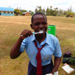 The Water Project: Musango Mixed Secondary School -  Participant Brushing Her Teeth