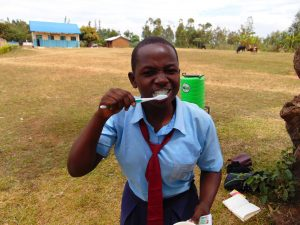 The Water Project:  Participant Brushing Her Teeth