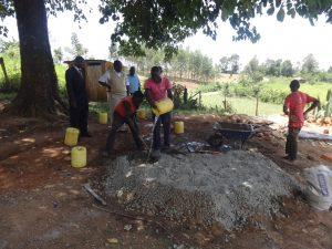 The Water Project:  Mixing Cement For Latrines