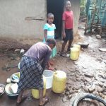 The Water Project: Sasala Community, Kasit Spring -  Using Spring Water To Wash Utensils