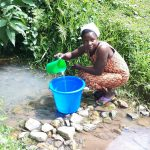 The Water Project: Buyangu Community, Osundwa Spring -  Fetching Water