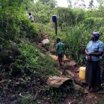 The Water Project: Chepnonochi Community, Shikati Spring -  Carrying Water