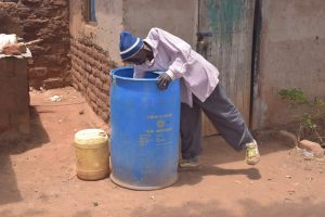 The Water Project:  Fetching Water From Container