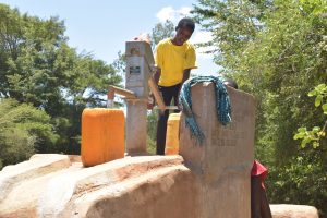 The Water Project:  Filling Water At First Community Well