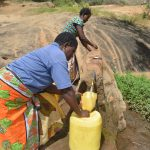 The Water Project: Wamwathi Community -  Fetching Water