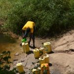 The Water Project: Wamwathi Community -  Fetching Water At Open Source