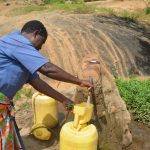 The Water Project: Wamwathi Community -  Fetching Water From Rock Catchment