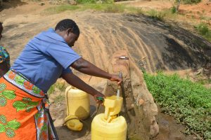 The Water Project:  Fetching Water From Rock Catchment