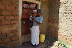 The Water Project:  Christine Musyoka Stands In Front Of Her Home