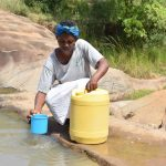 The Water Project: Kyamwao Community -  Fetching Water