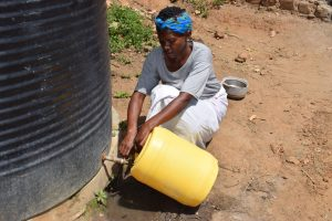 The Water Project:  Filling From Rainwater Tank