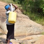 The Water Project: Kyamwao Community -  Hauling Water