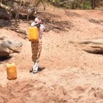 The Water Project: Kathonzweni Community A -  Carrying Water
