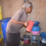 The Water Project: Kathonzweni Community A -  Fetching Water From Containers