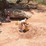 The Water Project: Kathonzweni Community A -  People Fetching Water