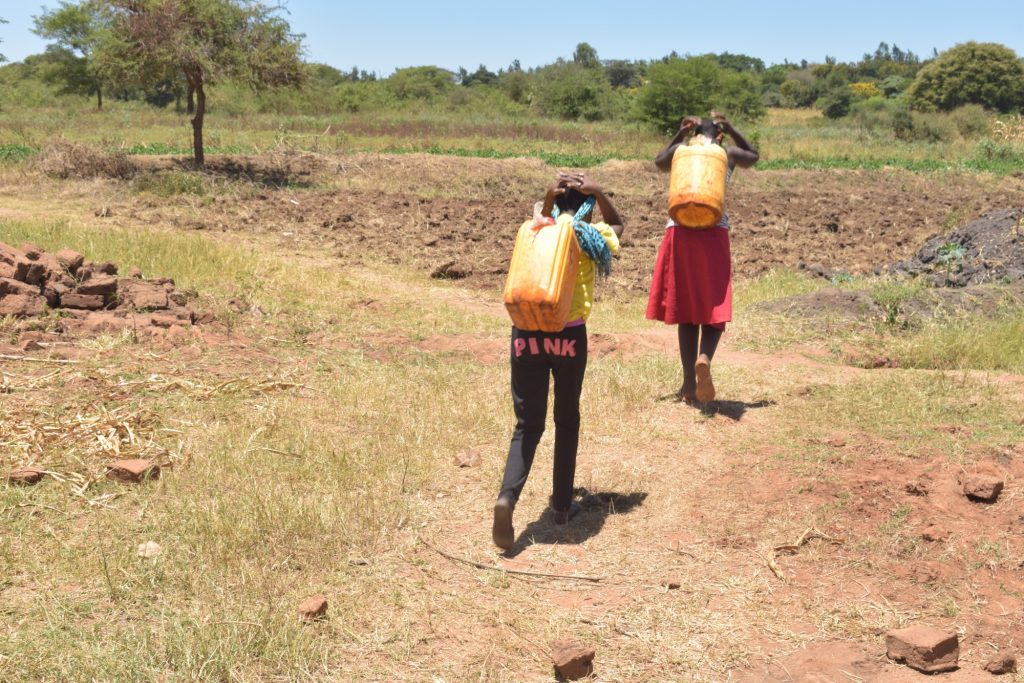 The Water Project : kenya19226-carrying-water-2
