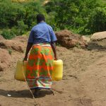 The Water Project: Wamwathi Community A -  Carrying Water