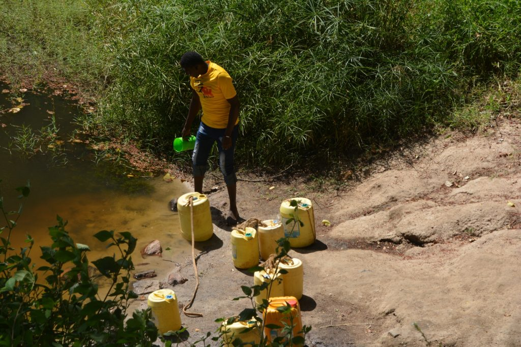 The Water Project : kenya19231-fetching-water-at-open-source