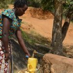 The Water Project: Wamwathi Community A -  Fetching Water At Rock Catchment