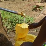 The Water Project: Wamwathi Community A -  Filling Water At Rock Catchment