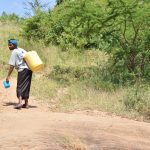 The Water Project: Kyamwao Community A -  Carrying Water