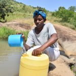 The Water Project: Kyamwao Community A -  Fetching Water