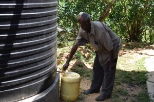 The Water Project:  Fetching Water From Tank