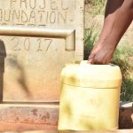 The Water Project: Kithumba Community E -  Collecting Water