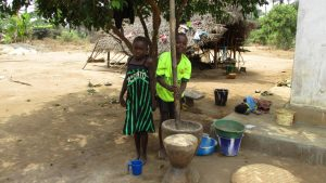 The Water Project:  Mashing Rice