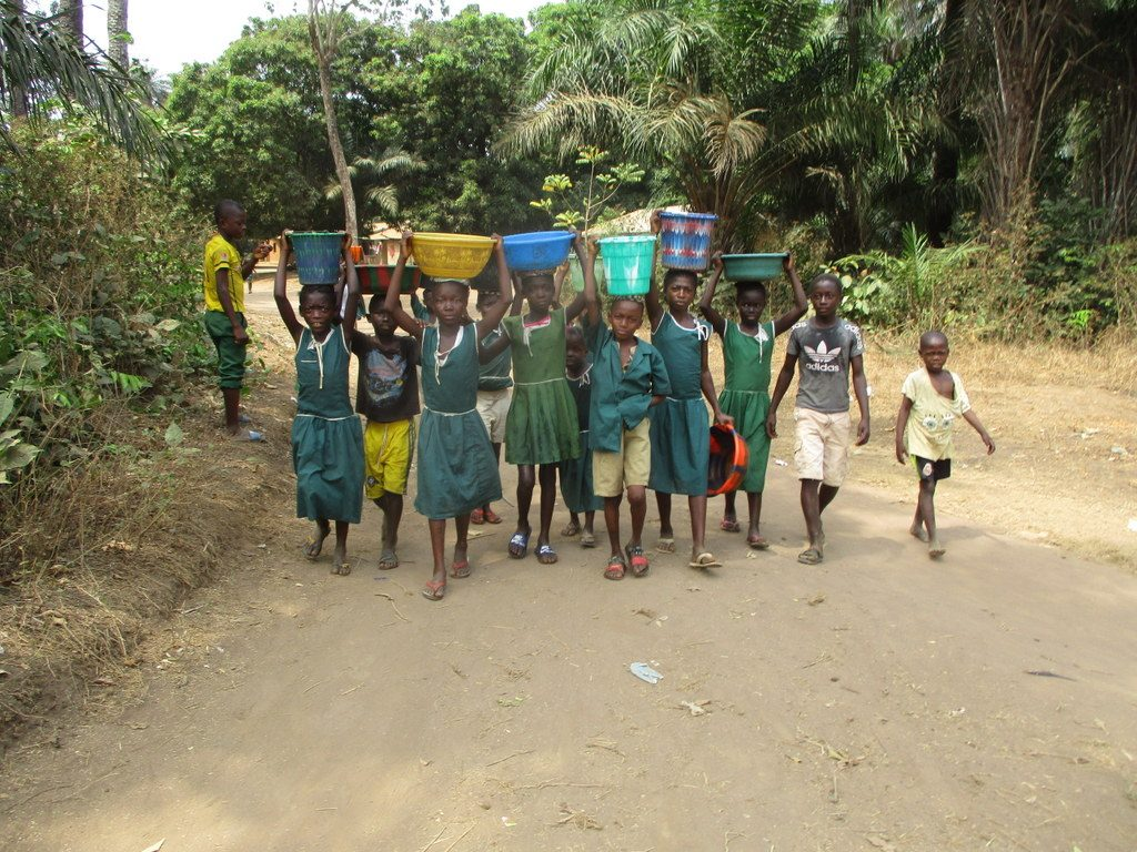 The Water Project : sierraleone19267-students-carrying-water