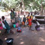 The Water Project: Lokomasama, Menika, DEC Menika Primary School -  Students Fetching Water