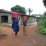 The Water Project: Mahera, SLMB Primary School -  Carrying Water
