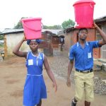 The Water Project: SLMB Primary School -  Carrying Water