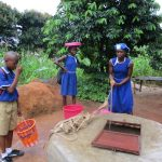 The Water Project: SLMB Primary School -  Fetching Water At Open Well