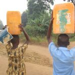 The Water Project: SLMB Primary School -  People Carrying Water